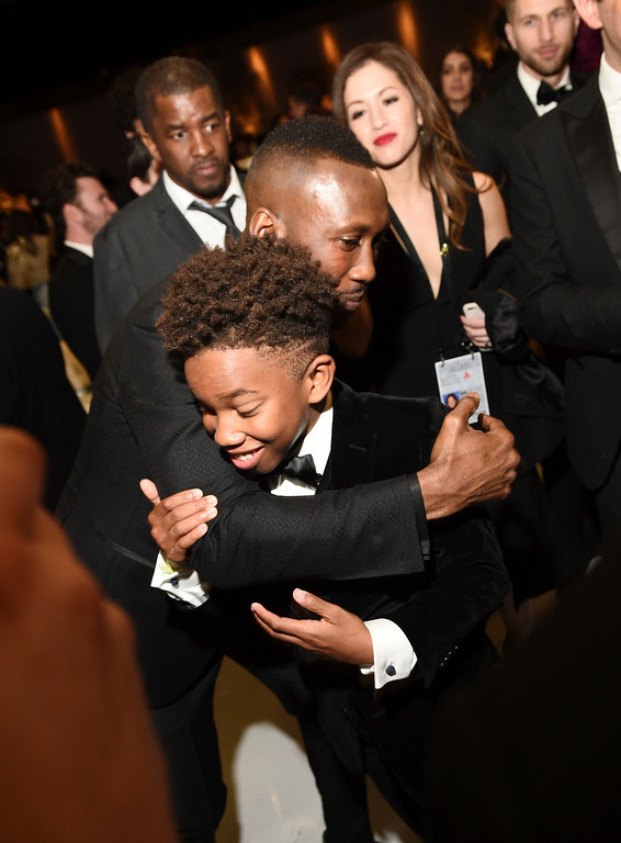 . Mahershala Ali, left, hugs Jaden Piner at the Governors Ball after the Oscars on Sunday, Feb. 26, 2017, at the Dolby Theatre in Los Angeles. (Photo by Al Powers/Invision/AP)