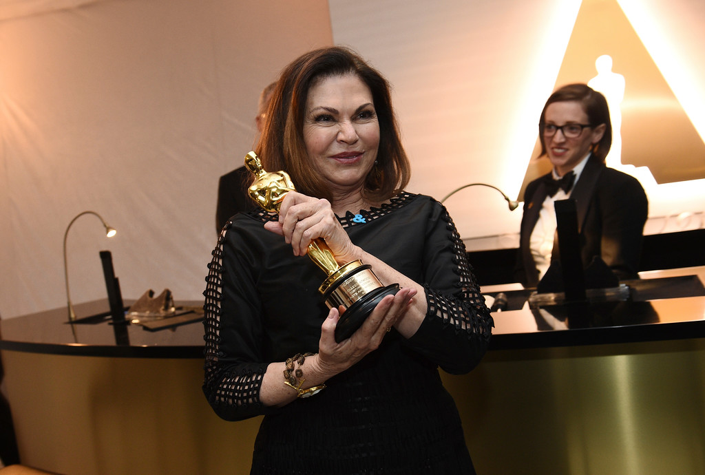 """. Colleen Atwood poses with the award for best costume design for \""""Fantastic Beasts and Where to Find Them\"""" at the Governors Ball after the Oscars on Sunday, Feb. 26, 2017, at the Dolby Theatre in Los Angeles. (Photo by Al Powers/Invision/AP)"""