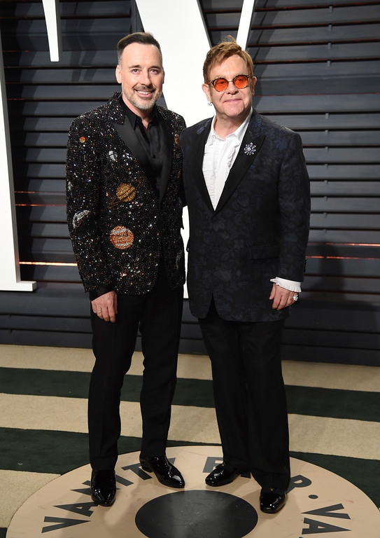 . David Furnish, left, and Elton John arrive at the Vanity Fair Oscar Party on Monday, Feb. 27, 2017, in Beverly Hills, Calif. (Photo by Evan Agostini/Invision/AP)
