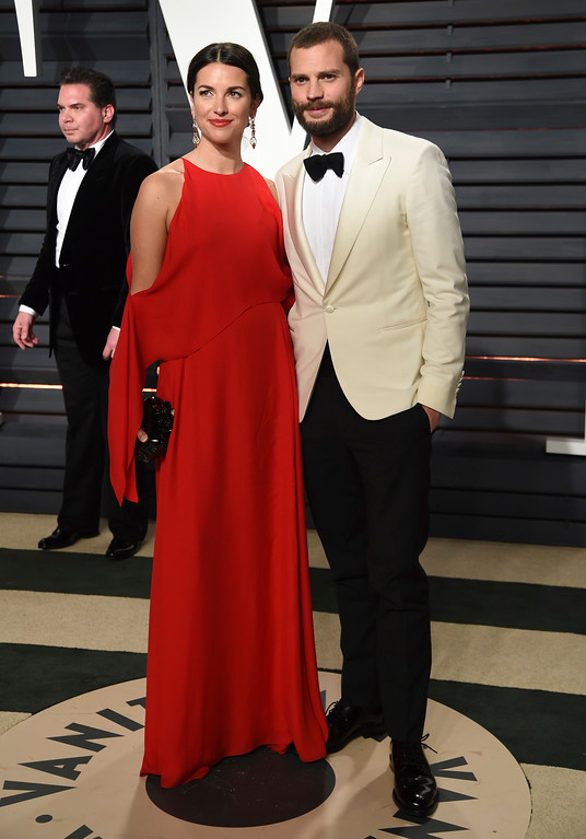 . Amelia Warner, left, and Jamie Dornan arrives at the Vanity Fair Oscar Party on Monday, Feb. 27, 2017, in Beverly Hills, Calif. (Photo by Evan Agostini/Invision/AP)