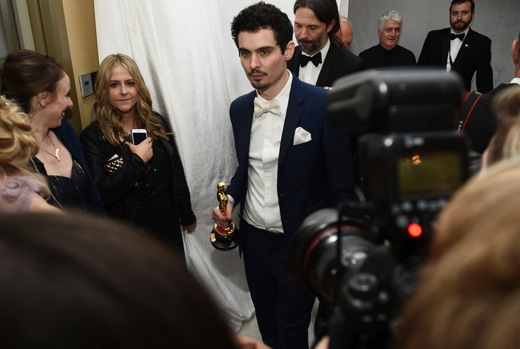 """. Damien Chazelle poses with the award for best director for \""""La La Land\"""" at the Governors Ball after the Oscars on Sunday, Feb. 26, 2017, at the Dolby Theatre in Los Angeles. (Photo by Al Powers/Invision/AP)"""