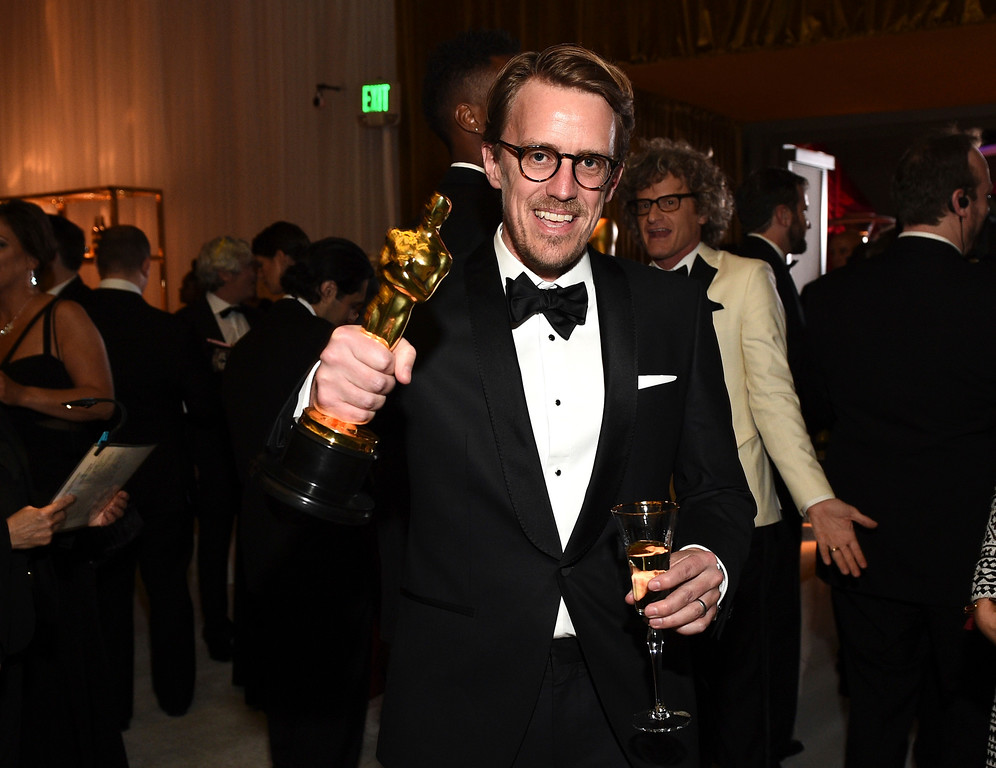 """. Andrew R. Jones poses with his award for best visual effects for \""""The Jungle Book\"""" at the Governors Ball after the Oscars on Sunday, Feb. 26, 2017, at the Dolby Theatre in Los Angeles. (Photo by Al Powers/Invision/AP)"""