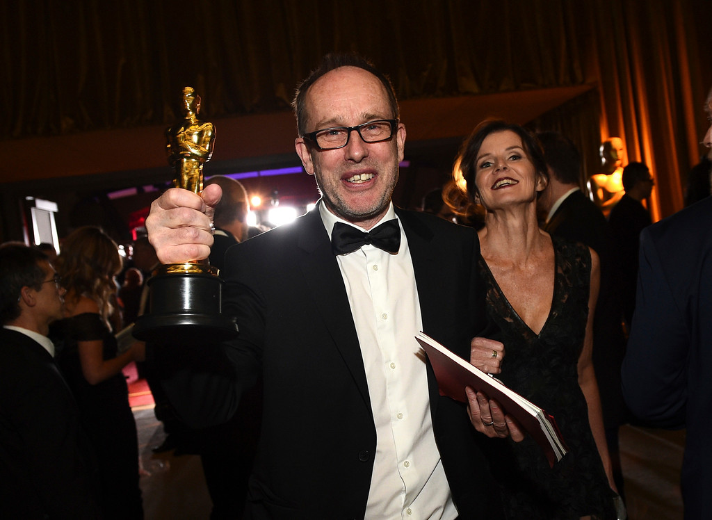 """. John Gilbert poses with his award for best film editing for \""""Hacksaw Ridge\"""" at the Governors Ball after the Oscars on Sunday, Feb. 26, 2017, at the Dolby Theatre in Los Angeles. (Photo by Al Powers/Invision/AP)"""