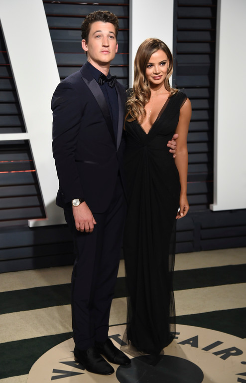 . Miles Teller, left, and Keleigh Sperry arrive at the Vanity Fair Oscar Party on Sunday, Feb. 26, 2017, in Beverly Hills, Calif. (Photo by Evan Agostini/Invision/AP)