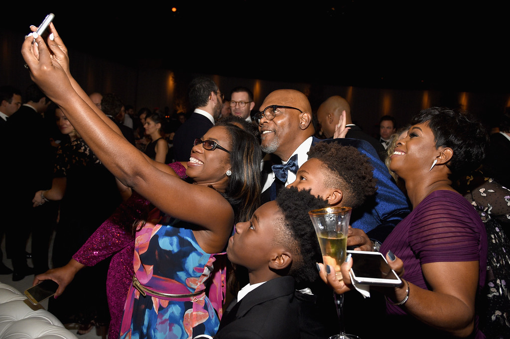 . HOLLYWOOD, CA - FEBRUARY 26: Actor Samuel L. Jackson (C) takes a selfie with Jaden Piner, Alex R. Hibbert and guests during the 89th Annual Academy Awards Governors Ball at Hollywood & Highland Center on February 26, 2017 in Hollywood, California.  (Photo by Kevork Djansezian/Getty Images)