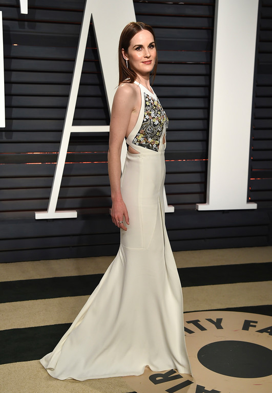 . Michelle Dockery arrives at the Vanity Fair Oscar Party on Monday, Feb. 27, 2017, in Beverly Hills, Calif. (Photo by Evan Agostini/Invision/AP)