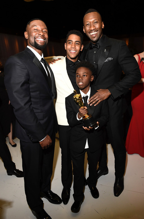 """. Shariff Earp, from left, Ashton Sanders, Alex R. Hibbert and Mahershala Ali pose with Mahershala\'s award for Actor in a Supporting Role for \""""Moonlight\"""" at the Governors Ball after the Oscars on Sunday, Feb. 26, 2017, at the Dolby Theatre in Los Angeles. (Photo by Al Powers/Invision/AP)"""