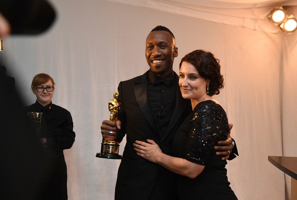 """. Mahershala Ali, left, with Adele Romanski, poses with his award for best actor in a supporting role for \""""Moonlight\"""" at the Governors Ball after the Oscars on Sunday, Feb. 26, 2017, at the Dolby Theatre in Los Angeles. (Photo by Al Powers/Invision/AP)"""
