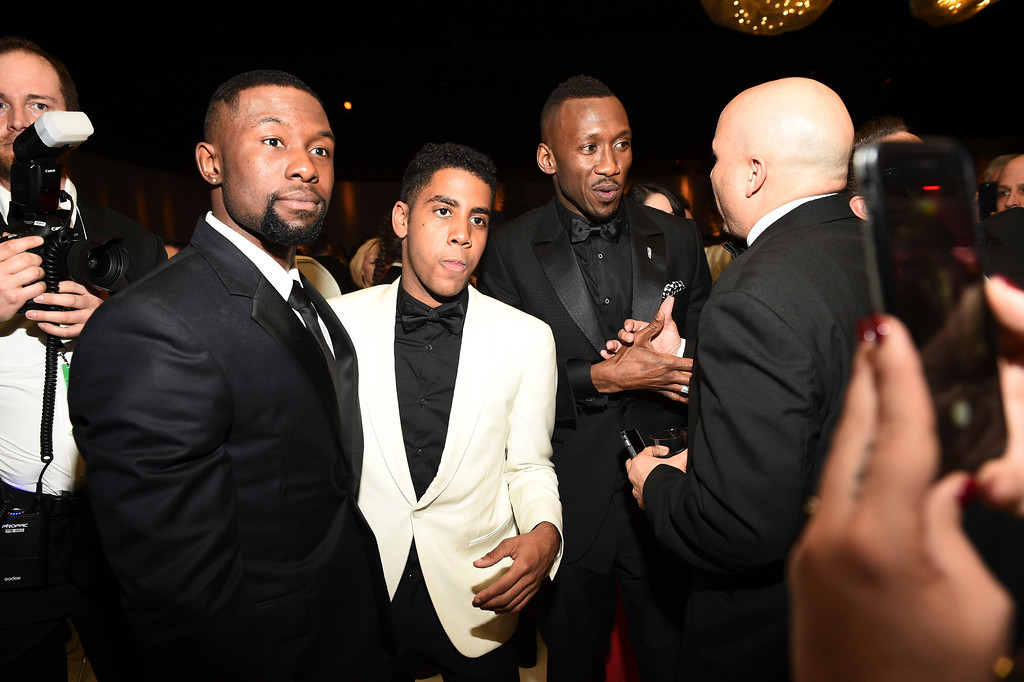. Shariff Earp, from left, Ashton Sanders and Mahershala Ali attend the Governors Ball after the Oscars on Sunday, Feb. 26, 2017, at the Dolby Theatre in Los Angeles. (Photo by Al Powers/Invision/AP)
