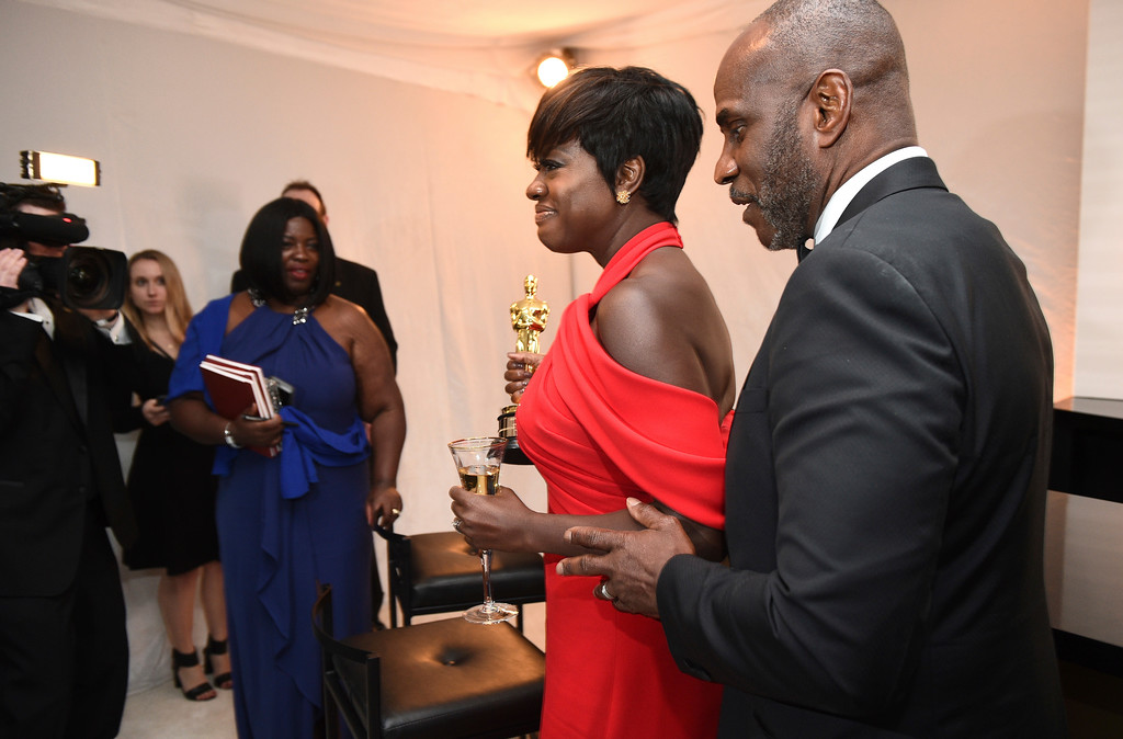 . Viola Davis, left, the winner of the award for Actress in a Leading Role for \'Fences,\' and Julius Harris attend the Governors Ball after the Oscars on Sunday, Feb. 26, 2017, at the Dolby Theatre in Los Angeles. (Photo by Al Powers/Invision/AP)