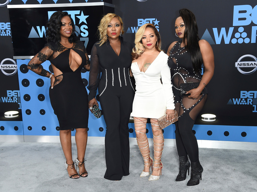 ". Kandi Burruss, from left, LaTocha Scott, Tameka ""Tiny\"" Cottle and Tamika Scott, of Xscape, arrive at the BET Awards at the Microsoft Theater on Sunday, June 25, 2017, in Los Angeles. (Photo by Richard Shotwell/Invision/AP)"