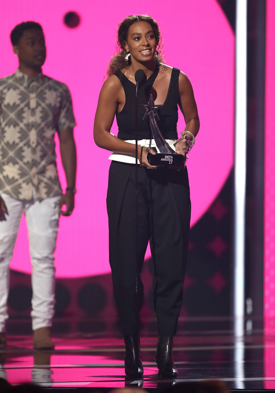 """. Solange accepts the centric award for \""""Cranes in the Sky\"""" at the BET Awards at the Microsoft Theater on Sunday, June 25, 2017, in Los Angeles. (Photo by Matt Sayles/Invision/AP)"""