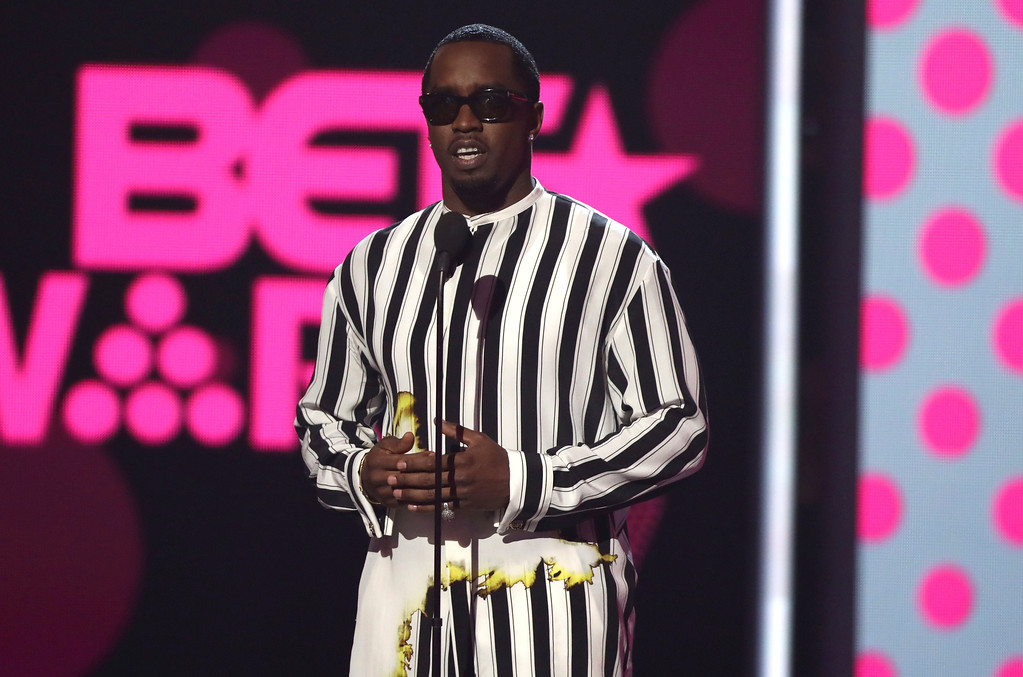 """. Sean \""""Puff Daddy\"""" Combs presents the award for best new artist at the BET Awards at the Microsoft Theater on Sunday, June 25, 2017, in Los Angeles. (Photo by Matt Sayles/Invision/AP)"""