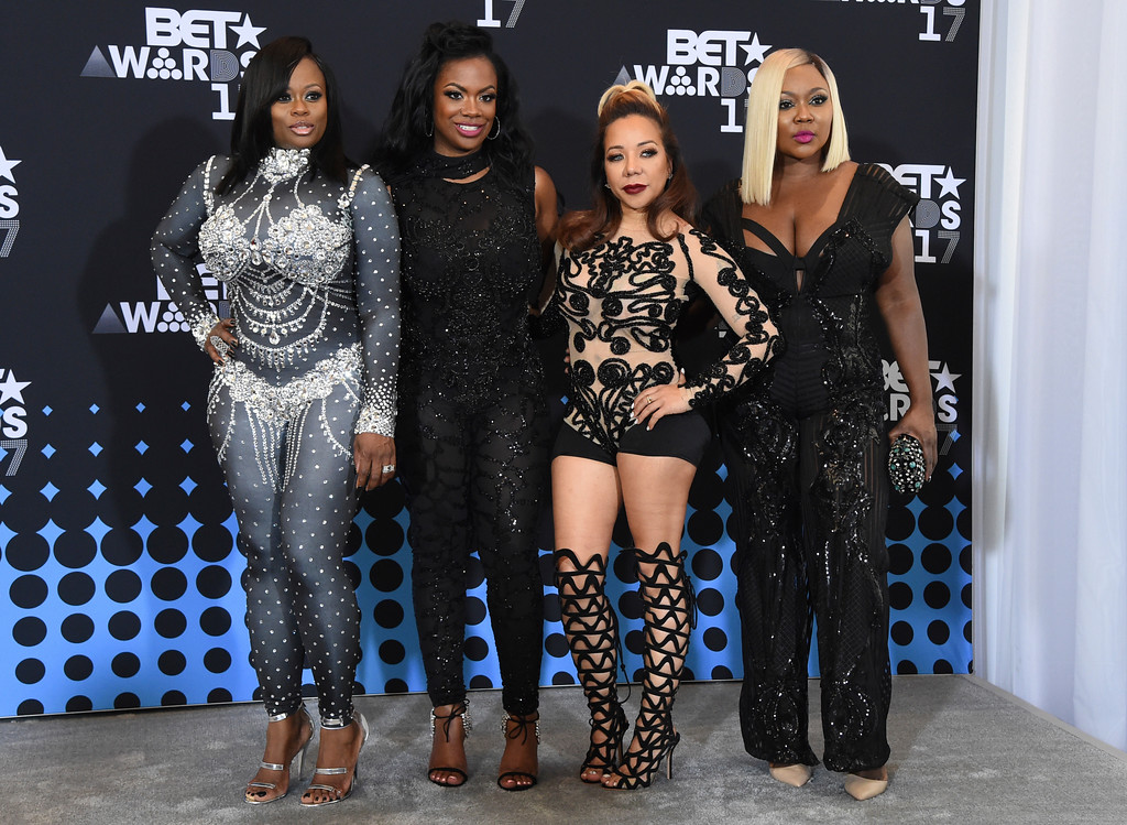 """. Tamika Scott, from left, Kandi Burruss, Tameka \""""Tiny\"""" Cottle, and LaTocha Scott, members of Xscape, pose in the press room at the BET Awards at the Microsoft Theater on Sunday, June 25, 2017, in Los Angeles. (Photo by Richard Shotwell/Invision/AP)"""