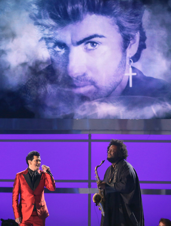 """. Kamasi Washington, right, and El DeBarge perform \""""Careless Whisper\"""" as a picture of George Michael appears on screen during an in memoriam tribute at the BET Awards at the Microsoft Theater on Sunday, June 25, 2017, in Los Angeles. (Photo by Matt Sayles/Invision/AP)"""