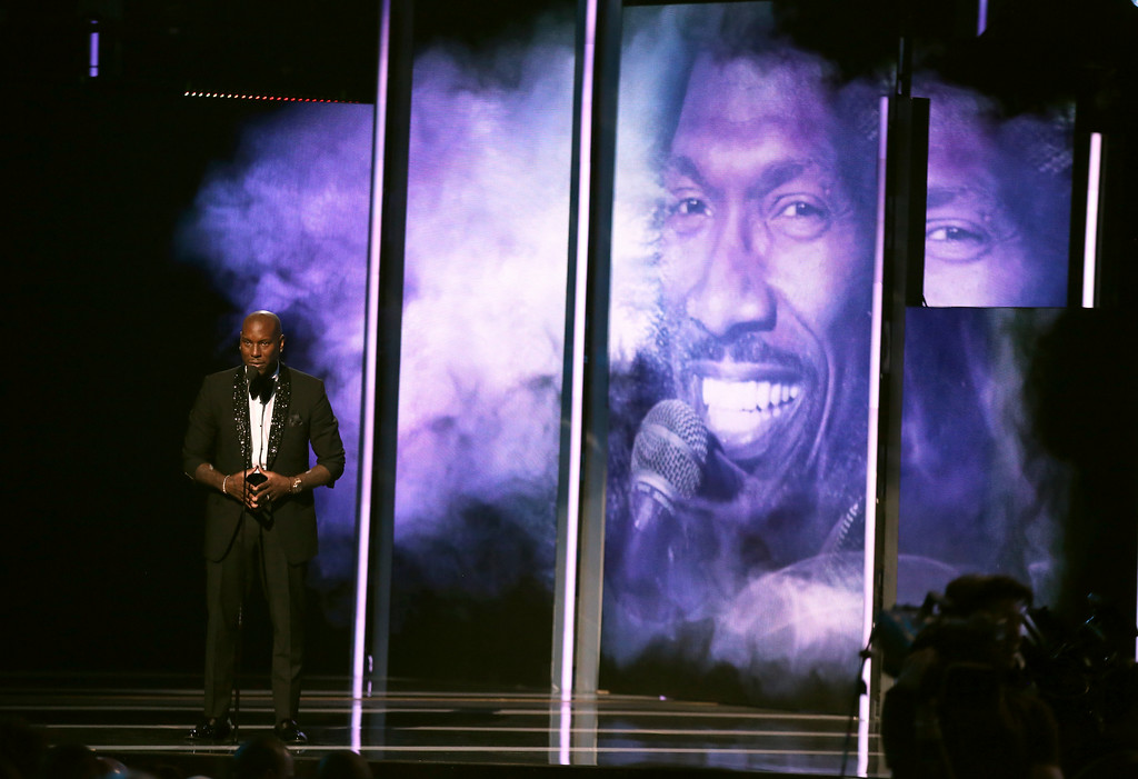 . Tyrese Gibson presents an in memoriam tribute at the BET Awards at the Microsoft Theater on Sunday, June 25, 2017, in Los Angeles. Charlie Murphy appears on screen. (Photo by Matt Sayles/Invision/AP)