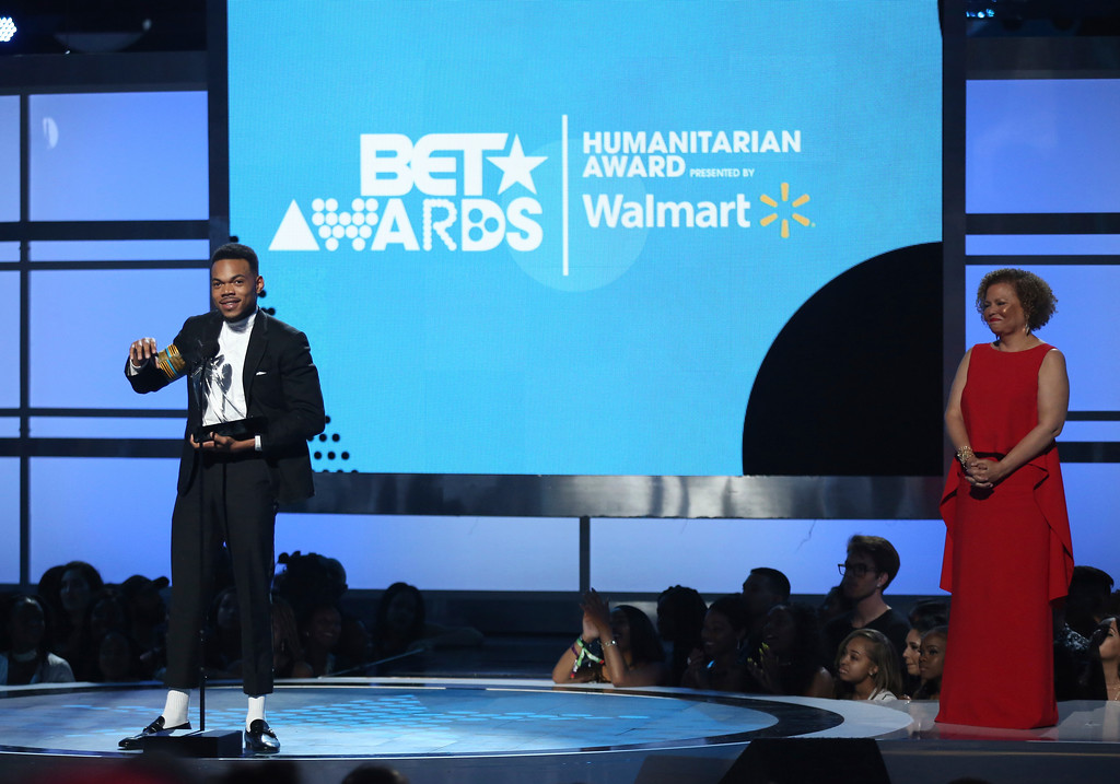 . Chance The Rapper accepts the humanitarian award at the BET Awards at the Microsoft Theater on Sunday, June 25, 2017, in Los Angeles. Debra Lee, chairman and CEO, BET, looks on from right. (Photo by Matt Sayles/Invision/AP)