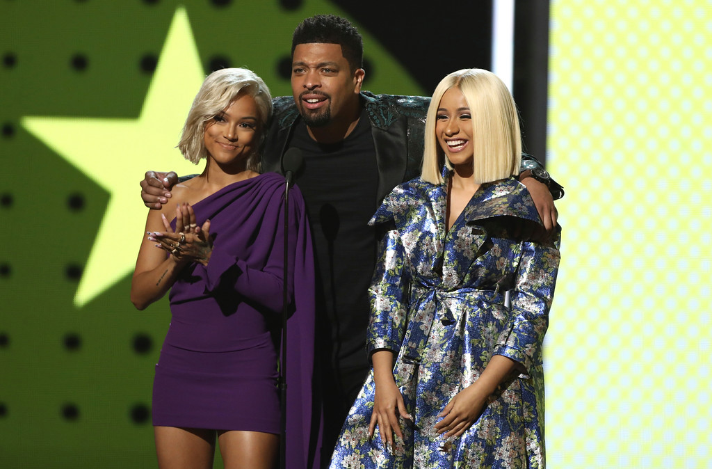 . Karrueche Tran, from left, Cardi B and DeRay Davis present the young stars award at the BET Awards at the Microsoft Theater on Sunday, June 25, 2017, in Los Angeles. (Photo by Matt Sayles/Invision/AP)