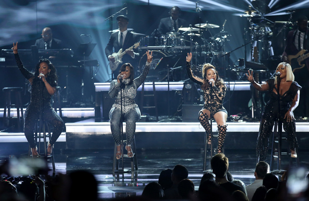 . Kandi Burruss, from left, Tamika Scott, Tameka Cottle, and LaTocha Scott of Xscape perform at the BET Awards at the Microsoft Theater on Sunday, June 25, 2017, in Los Angeles. (Photo by Matt Sayles/Invision/AP)