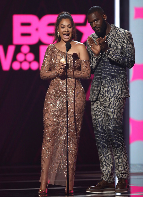 . La La Anthony, left, and Kofi Siriboe present the Dr. Bobby Jones best gospel/inspirational award at the BET Awards at the Microsoft Theater on Sunday, June 25, 2017, in Los Angeles. (Photo by Matt Sayles/Invision/AP)