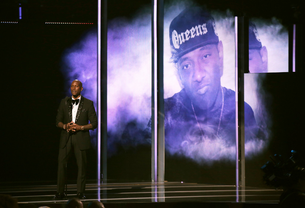 . Tyrese Gibson presents an in memoriam tribute at the BET Awards at the Microsoft Theater on Sunday, June 25, 2017, in Los Angeles. Rapper Prodigy appears on screen. (Photo by Matt Sayles/Invision/AP)