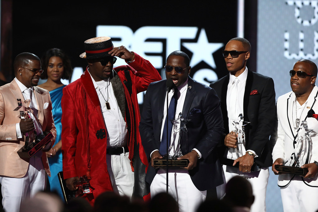 . Ricky Bell, from left, Bobby Brown, Johnny Gill, Ronnie DeVoe and Michael Bivins, of New Edition, accept the lifetime achievement award at the BET Awards at the Microsoft Theater on Sunday, June 25, 2017, in Los Angeles. (Photo by Matt Sayles/Invision/AP)