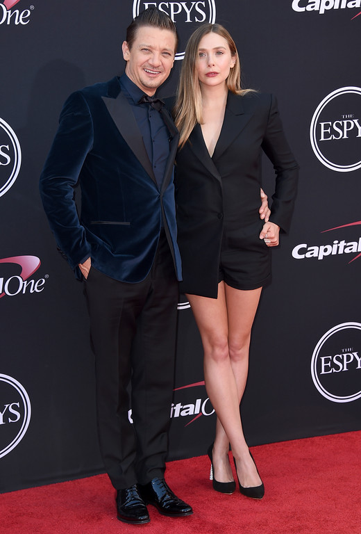 . Jeremy Renner, left, and Elizabeth Olsen arrive at the ESPYS at the Microsoft Theater on Wednesday, July 12, 2017, in Los Angeles. (Photo by Jordan Strauss/Invision/AP)