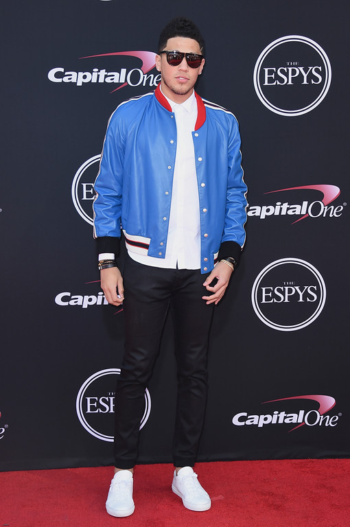 . NBA basketball player, Devin Booker, of the Phoenix Suns arrives at the ESPYS at the Microsoft Theater on Wednesday, July 12, 2017, in Los Angeles. (Photo by Jordan Strauss/Invision/AP)