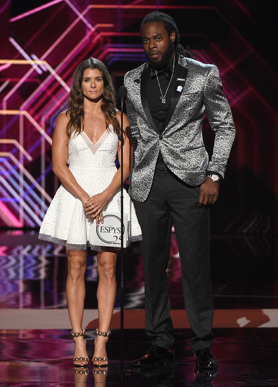 . Danica Patrick, left, and Richard Sherman present the award for best record-breaking performance at the ESPYS at the Microsoft Theater on Wednesday, July 12, 2017, in Los Angeles. (Photo by Chris Pizzello/Invision/AP)