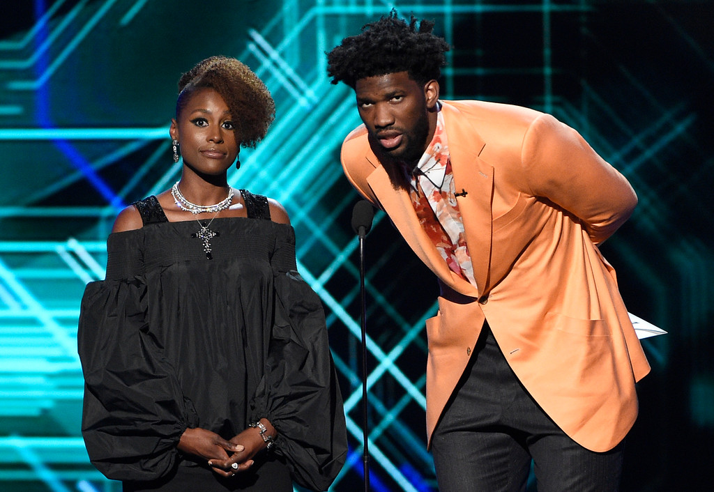 . Issa Rae, left, and Joel Embiid present the award for best championship performance at the ESPYS at the Microsoft Theater on Wednesday, July 12, 2017, in Los Angeles. (Photo by Chris Pizzello/Invision/AP)