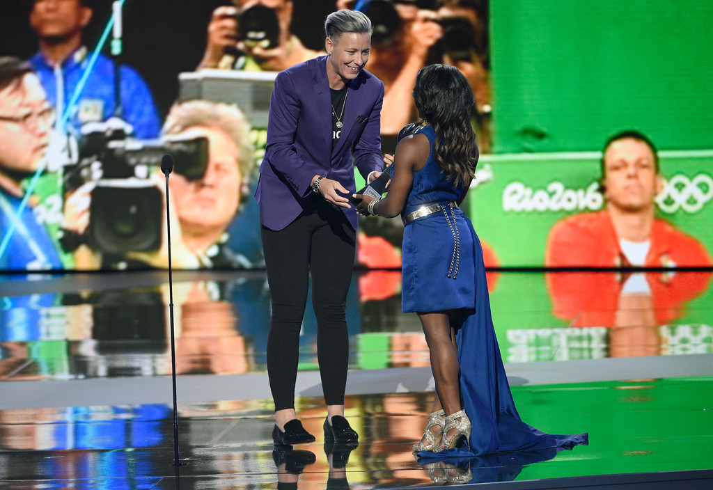 . Abby Wambach, left, presents the award for best female athlete to gymnast Simone Biles at the ESPYS at the Microsoft Theater on Wednesday, July 12, 2017, in Los Angeles. (Photo by Chris Pizzello/Invision/AP)