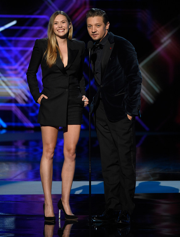 . Elizabeth Olsen, left, and Jeremy Renner present the award for best breakthrough athlete at the ESPYS at the Microsoft Theater on Wednesday, July 12, 2017, in Los Angeles. (Photo by Chris Pizzello/Invision/AP)