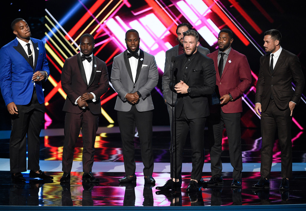 . NFL football player Julian Edelman, of the New England Patriots, accepts the award for best game for Super Bowl LI at the ESPYS at the Microsoft Theater on Wednesday, July 12, 2017, in Los Angeles. Pictured from left, Trey Flowers, Dion Lewis, James White, Nate Ebner, Malcolm Butler and Danny Amendola. (Photo by Chris Pizzello/Invision/AP)
