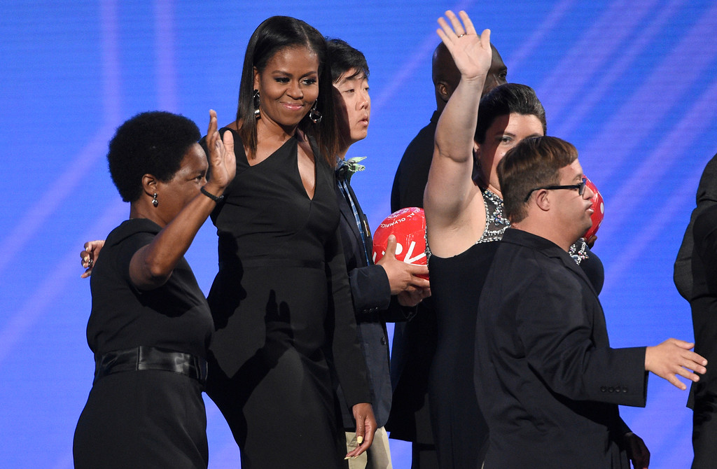 . Former first lady Michelle Obama and Special Olympic athletes present the Arthur Ashe Courage Award at the ESPYS at the Microsoft Theater on Wednesday, July 12, 2017, in Los Angeles. (Photo by Chris Pizzello/Invision/AP)