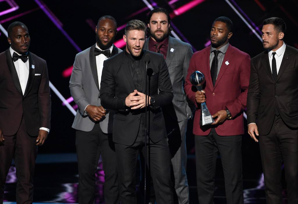 . NFL football player Julian Edelman, of the New England Patriots, accepts the award for best game at Super Bowl LI at the ESPYS at the Microsoft Theater on Wednesday, July 12, 2017, in Los Angeles. Pictured from left, Dion Lewis, James White, Nate Ebner, Malcolm Butler and Danny Amendola. (Photo by Chris Pizzello/Invision/AP)