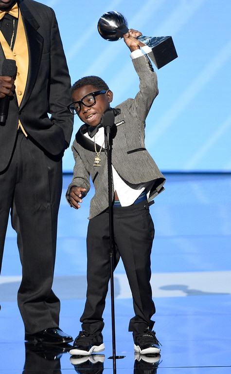 ". New Orleans Saints superfan Jarrius ""J.J.\"" Robertson accepts the Jimmy V perseverance award at the ESPYS at the Microsoft Theater on Wednesday, July 12, 2017, in Los Angeles. (Photo by Chris Pizzello/Invision/AP)"