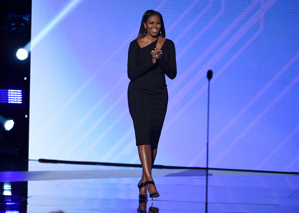 . Former first lady Michelle Obama walks on stage to present the Arthur Ashe Courage Award at the ESPYS at the Microsoft Theater on Wednesday, July 12, 2017, in Los Angeles. (Photo by Chris Pizzello/Invision/AP)