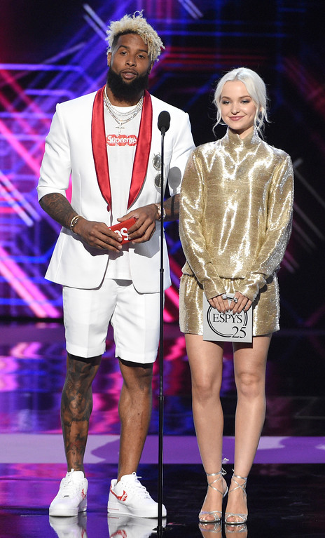 . Odell Beckham Jr., left, and Dove Cameron present the award for best play at the ESPYS at the Microsoft Theater on Wednesday, July 12, 2017, in Los Angeles. (Photo by Chris Pizzello/Invision/AP)