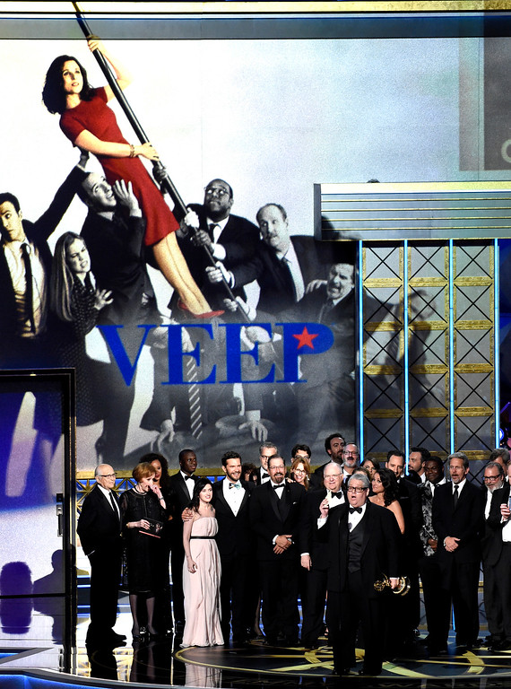 ". Frank Rich and cast accept the award for outstanding comedy series for ""Veep\"" at the 69th Primetime Emmy Awards on Sunday, Sept. 17, 2017, at the Microsoft Theater in Los Angeles. (Photo by Chris Pizzello/Invision/AP)"