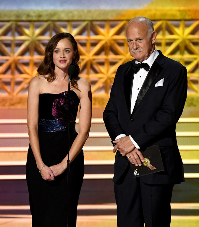 . LOS ANGELES, CA - SEPTEMBER 17:  Actors Alexis Bledel (L) and Gerald McRaney speak onstage during the 69th Annual Primetime Emmy Awards at Microsoft Theater on September 17, 2017 in Los Angeles, California.  (Photo by Kevin Winter/Getty Images)