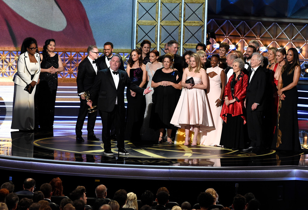 """. Bruce Miller and the cast and crew accept the award for outstanding drama series for \""""The Handmaid\'s Tale\"""" at the 69th Primetime Emmy Awards on Sunday, Sept. 17, 2017, at the Microsoft Theater in Los Angeles. (Photo by Chris Pizzello/Invision/AP)"""