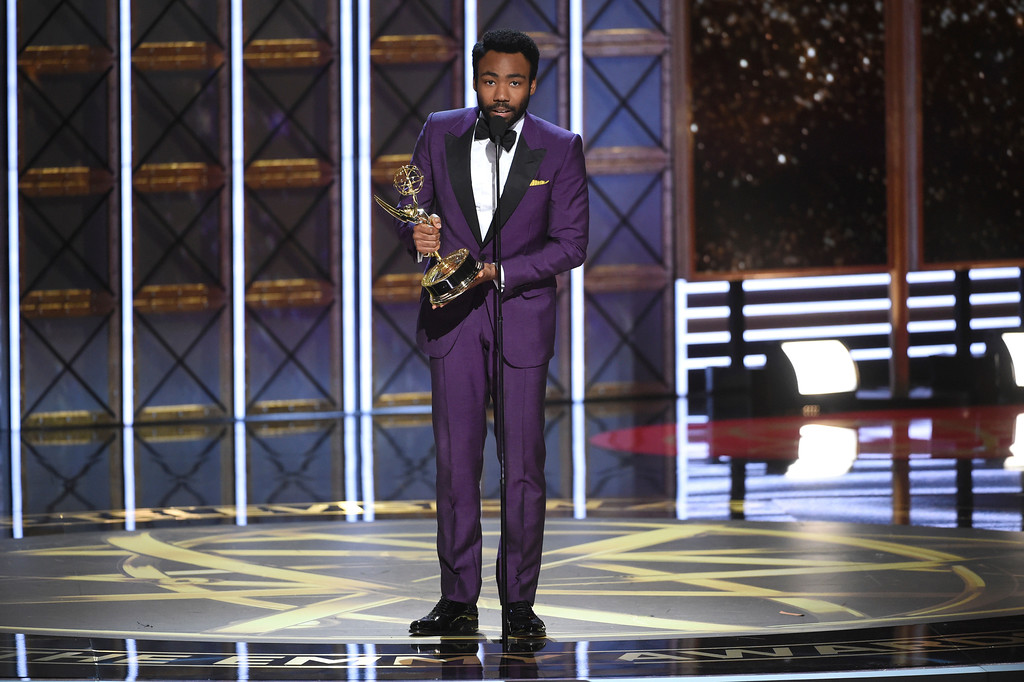 ". Donald Glover accepts the award for outstanding directing for a comedy series for the ""Atlanta\"" episode \""B.A.N.\"" at the 69th Primetime Emmy Awards on Sunday, Sept. 17, 2017, at the Microsoft Theater in Los Angeles. (Photo by Phil McCarten/Invision for the Television Academy/AP Images)"