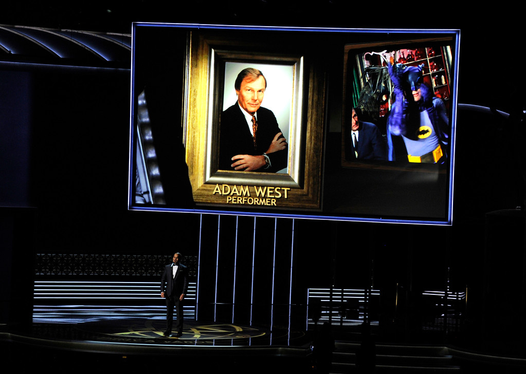 . Christopher Jackson sings as a picture of Adam West appears onscreen during an in memoriam tribute at the 69th Primetime Emmy Awards on Sunday, Sept. 17, 2017, at the Microsoft Theater in Los Angeles. (Photo by Chris Pizzello/Invision/AP)
