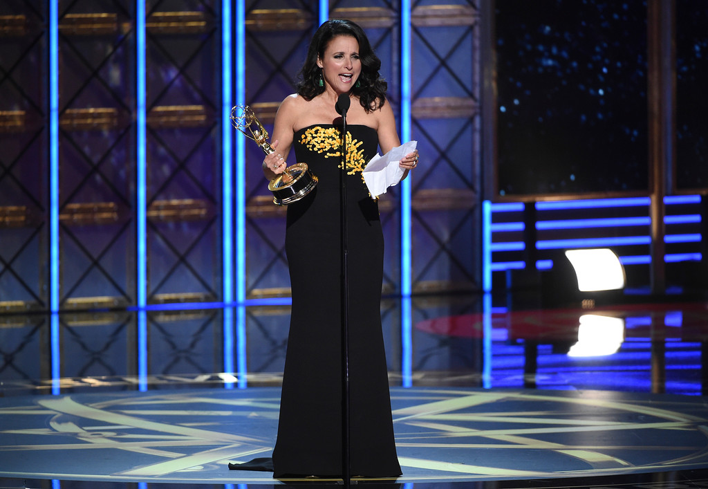 ". Julia Louis-Dreyfus accepts the award for outstanding lead actress in a comedy series for ""Veep\"" at the 69th Primetime Emmy Awards on Sunday, Sept. 17, 2017, at the Microsoft Theater in Los Angeles. (Photo by Phil McCarten/Invision for the Television Academy/AP Images)"