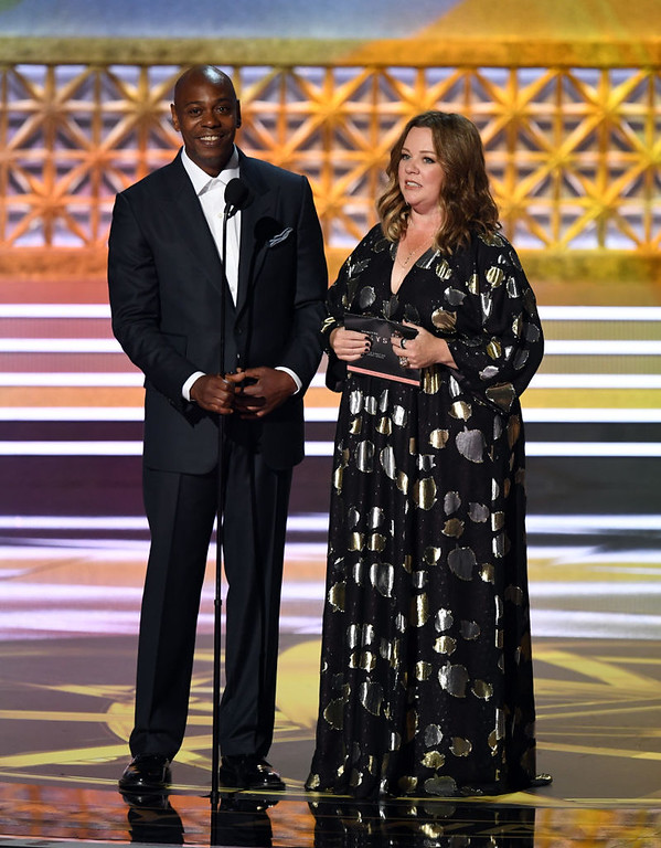 . LOS ANGELES, CA - SEPTEMBER 17:  Comedian Dave Chappelle (L) and actor Melissa McCarthy speak onstage during the 69th Annual Primetime Emmy Awards at Microsoft Theater on September 17, 2017 in Los Angeles, California.  (Photo by Kevin Winter/Getty Images)