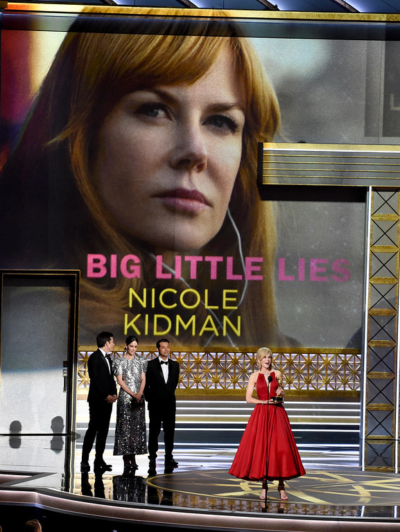 """. Nicole Kidman, accepts the award for outstanding lead actress in a limited series or a movie for \""""Big Little Lies\"""" as Jason Bateman, center left, and Sarah Paulson look on at the 69th Primetime Emmy Awards on Sunday, Sept. 17, 2017, at the Microsoft Theater in Los Angeles. (Photo by Chris Pizzello/Invision/AP)"""