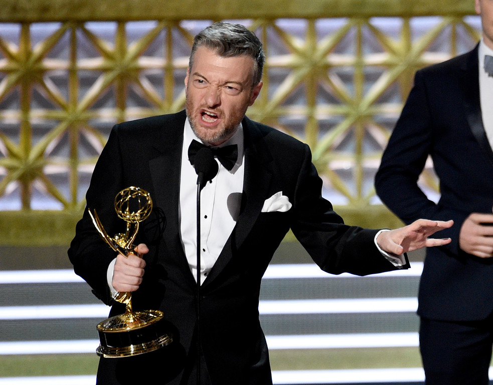 """. Charlie Brooker accepts the award for outstanding television movie for \""""Black Mirror: San Junipero\"""" at the 69th Primetime Emmy Awards on Sunday, Sept. 17, 2017, at the Microsoft Theater in Los Angeles. (Photo by Chris Pizzello/Invision/AP)"""