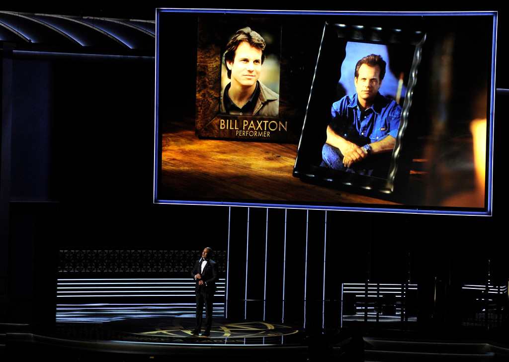 . Christopher Jackson sings as a picture of Bill Paxton appears onscreen during an in memoriam tribute at the 69th Primetime Emmy Awards on Sunday, Sept. 17, 2017, at the Microsoft Theater in Los Angeles. (Photo by Chris Pizzello/Invision/AP)