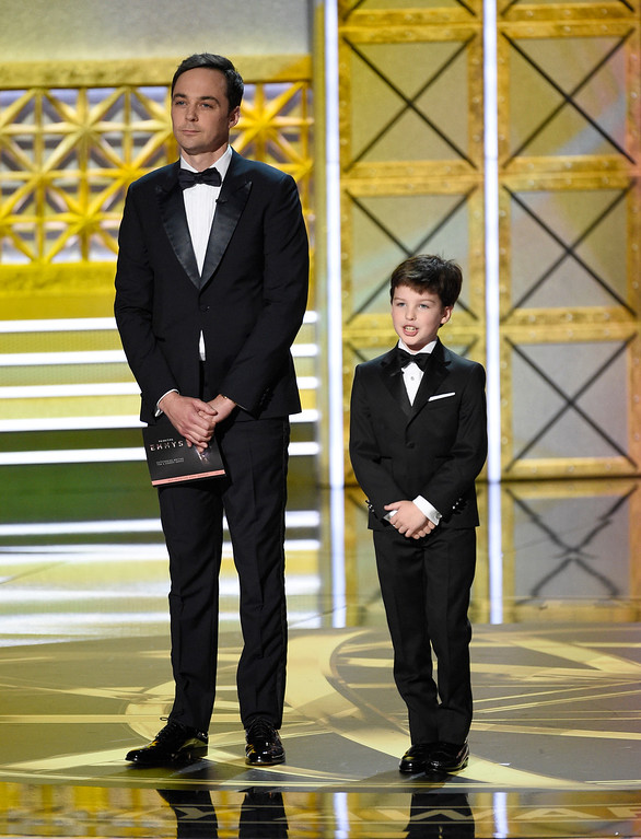 . Jim Parsons, left, and Iain Armitage present the award for outstanding writing for a comedy series at the 69th Primetime Emmy Awards on Sunday, Sept. 17, 2017, at the Microsoft Theater in Los Angeles. (Photo by Chris Pizzello/Invision/AP)