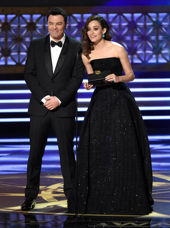 . Seth MacFarlane, left, and Emmy Rossum present the award for outstanding writing for a limited series, movie or a dramatic special at the 69th Primetime Emmy Awards on Sunday, Sept. 17, 2017, at the Microsoft Theater in Los Angeles. (Photo by Chris Pizzello/Invision/AP)
